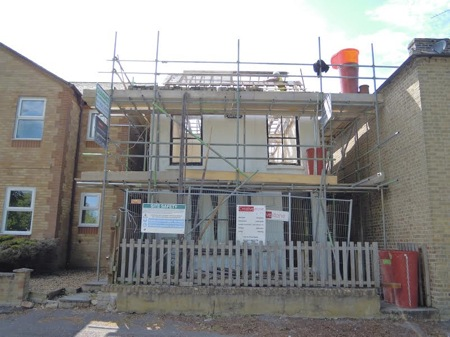 Demolition and new build, funded in stages.